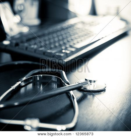 Stethoscope on a table with keyboard, very shallow DOF