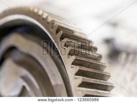 close up of vintage cogwheel on blurred background