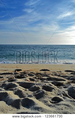 Incredible beautiful beach scenario with water and sand view