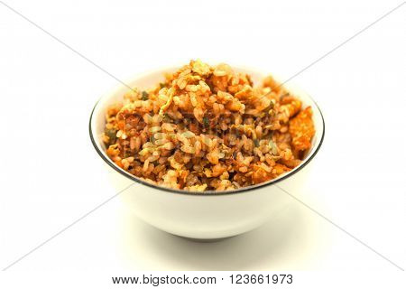Fried Chinese rice with vegetables and egg, in a bowl on a white background. Chinese favourite garnish