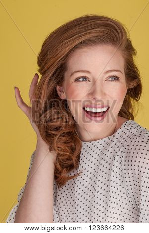happy smiling woman with freckles on yellow with blue eyes