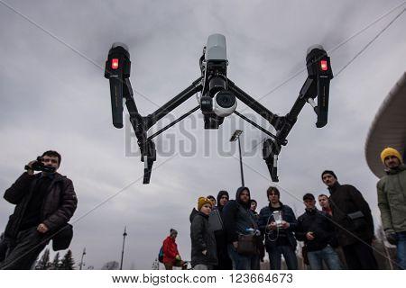 People Watch The Flight Of Dji Inspire 1 Drone Uav