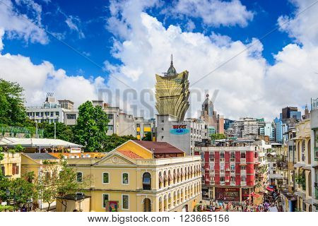 MACAU, CHINA - MAY 21, 2014: Crowds below the skyline of Macau. The former Portuguese coloy is a popular tourist attraction