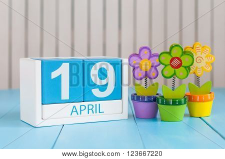 April 19th. Image of april 19 wooden color calendar on white background with flowers. Spring day, empty space for text. The Day Of Snowdrop.
