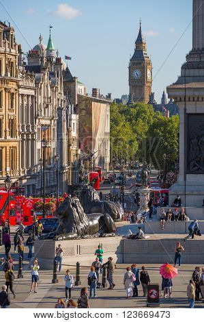 LONDON, UK - SEPTEMBER 10, 2015: Lots of people and tourists on the Trafalgar square in hot summer day. View includes Big Ben at the background