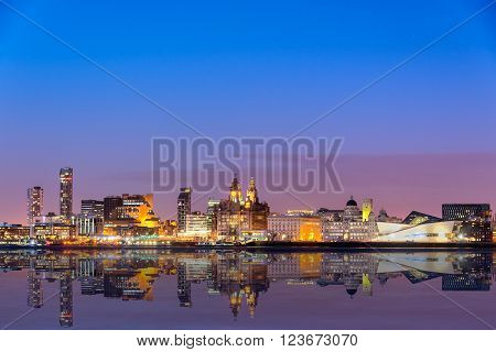 The Liverpool skyline from across Mersey river with all the major buildings such as Liverpool museum three graces Royal Liver building Port of Liverpool etc.