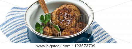 Small Meat Cutlets or Sausage Patties isolated on white background. Selective focus.