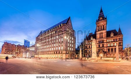 The old and new town hall buildings in the city center of Manchester England.