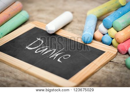 Slate with german word Danke which means thank you colorful chalk