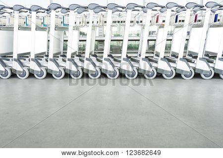trolleys luggage in a row in airport