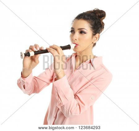 Beautiful young woman with wooden flute isolated on white