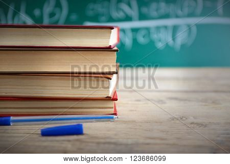 Few books with pen on table