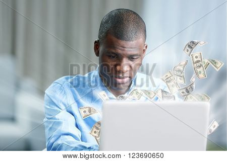 Financial concept. Make money on the Internet. African American businessman in blue shirt with laptop
