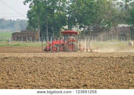 tractors plow the farm in local country