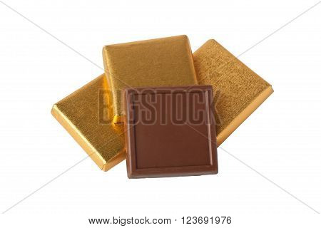 Pieces of chocolate in wrapper isolated on white background