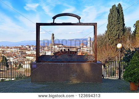 FLORENCE, Italy - January 18, 2016: creative look at the old Florence through the sculpture Partir by Jean Michel Folon, belgian artist in sweet rose garden on January 18, 2016 Florence, Tuscany, Italy