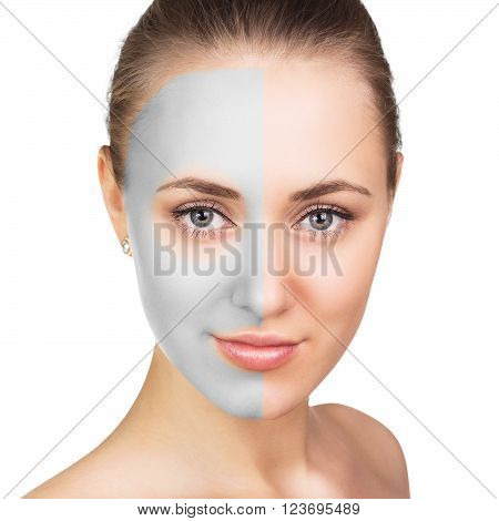 Young woman with clay face mask on her face
