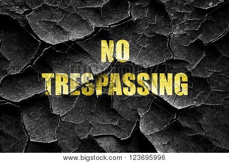Grunge cracked No trespassing sign with black and orange colors