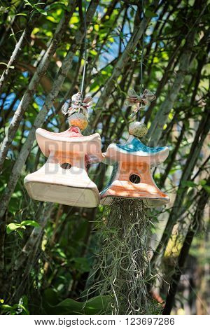 Ceramic bells and algae hanging on a tree. Thai style