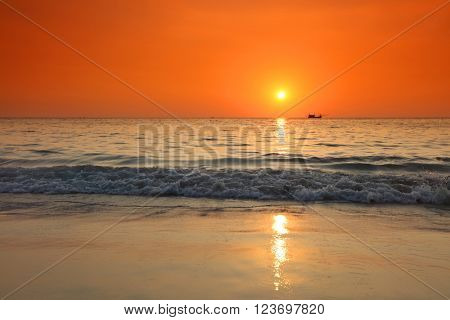 Beautiful sunset over sea and boat in Thailand