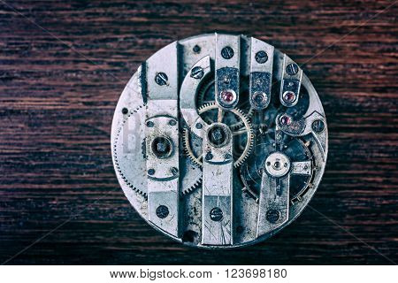 Mechanism of pocket clock with grunge texture close up.