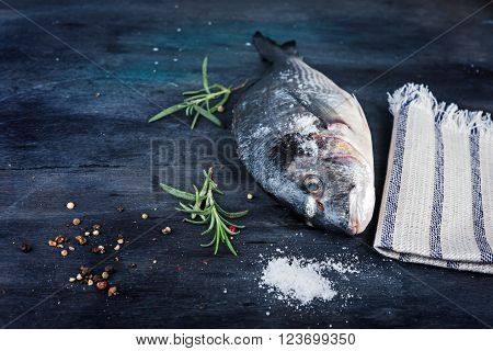 Raw dorado fish with rosemary and peper