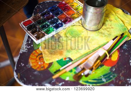 Paints brushes and other tools in the artist's studio