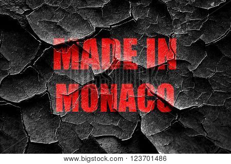 Grunge cracked Made in monaco with some soft smooth lines