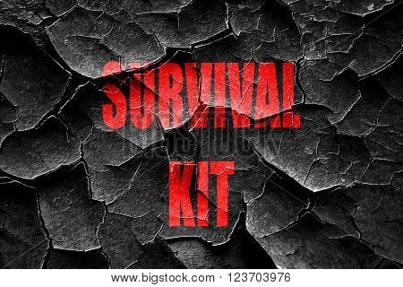 Grunge cracked Survival kit sign with some soft flowing lines