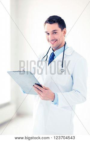 bright picture of male doctor writing prescription