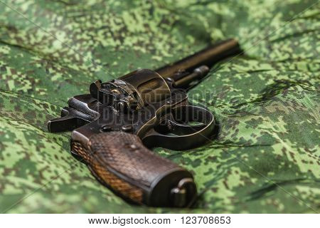 Vintage generic russian soviet 9mm pistol on pixel camouflage background