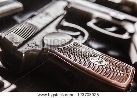 Detail shot of weathered generic russian soviet semi-automatic 9mm pistol on black background