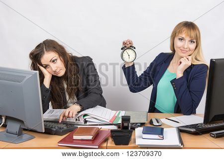 Two Office Workers Wait For The End Of The Working Day