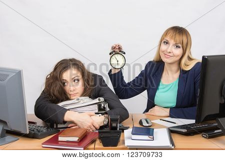 Two Girls In The Office At The End Of The Day, One Positive, The Other Exhausted