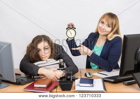 The Girl In The Office With A Smile, Indicating The Hours And Tortured Colleague