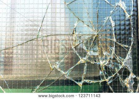 A digital photo of a broken industrial window.