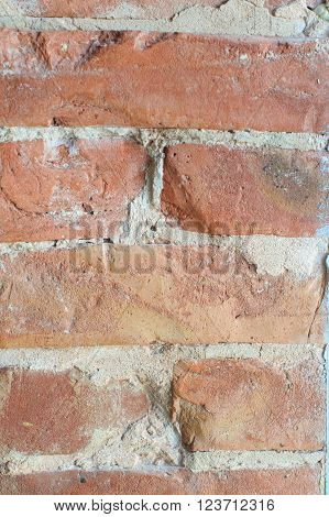Old brick wall. Red brick wall texture. Texture of old brickwork. brick and cement layer close-up.