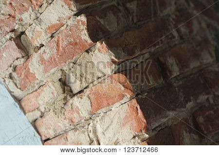 Part of old brick arch. Red brick wall texture. Texture of old brickwork. brick and cement layer close-up.