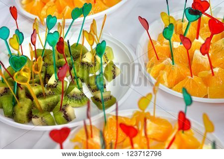 fresh slices of kiwi fruit and orange on the table