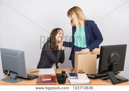 The Girl In The Office Is Facing The Box With Things And Says Goodbye To A Colleague