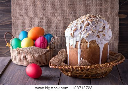Traditional easter cake with Easter eggs on the wooden table in rustic style