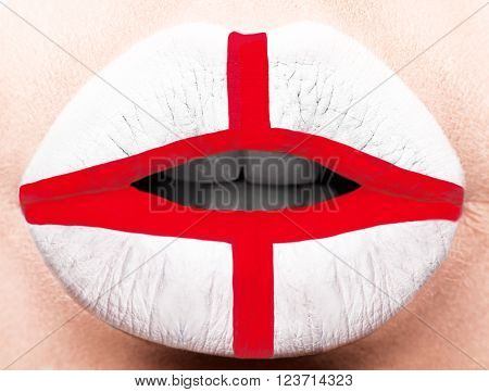 Female lips close up with a picture of the flag of England. white, red