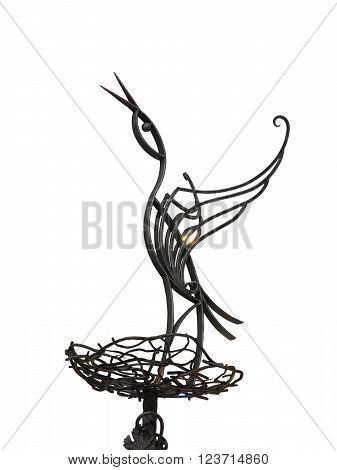Abstract metallic forged stork on nest isolated over white background