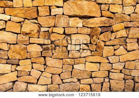 New decorative stone wall from sandstone blocks