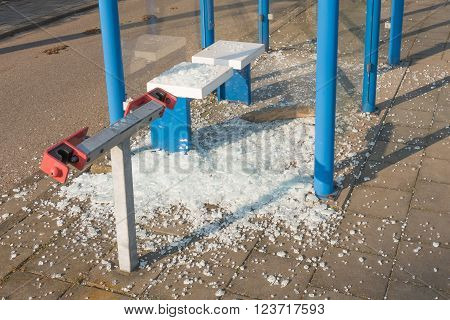 Bus shelter broken by vandals in Voorschoten Netherlands.
