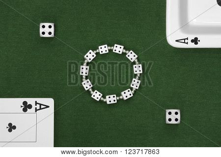 Poker cards dice and ashtray on green table