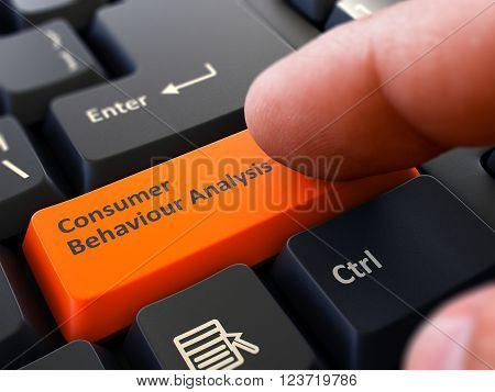 Consumer Behaviour Analysis Orange Button - Finger Pushing Button of Black Computer Keyboard. Blurred Background. Closeup View. 3D Render.