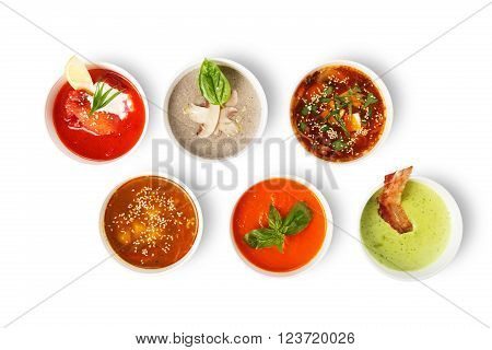 Variety of soups, restaurant hot dishes, healthy food. Japanese miso soup, asian fish soup, russian borscht, english pea soup, mushroom soup, spanish gazpacho isolated at white. Top view, flat lay.