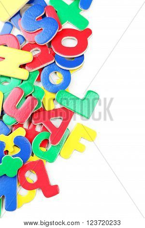 Magnetic plastic letters on a white background