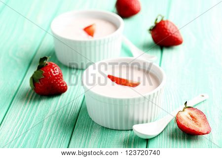 Strawberry Yogurt In Bowl On A Mint Wooden Table
